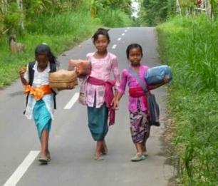 Off to school, Purnama. Taro